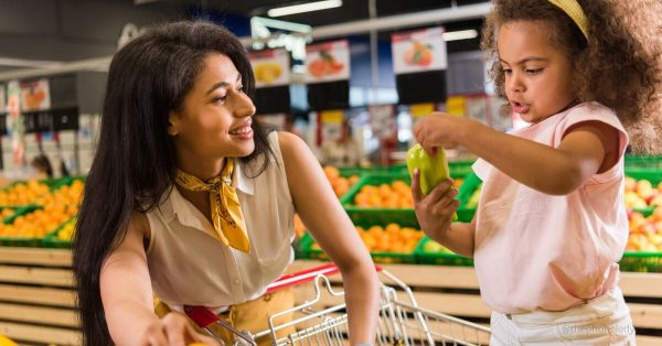mother and daughter in grocery store