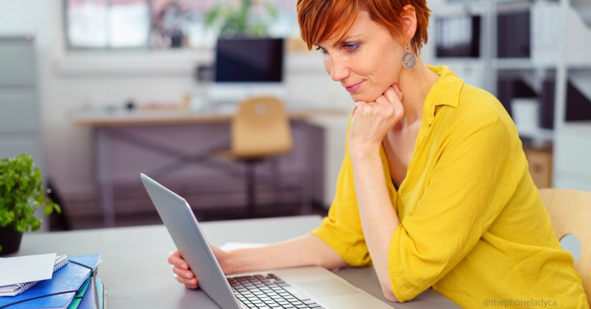 woman reading blog posts on laptop