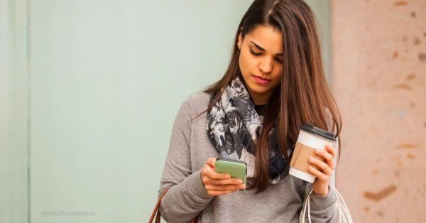 young woman reading text message
