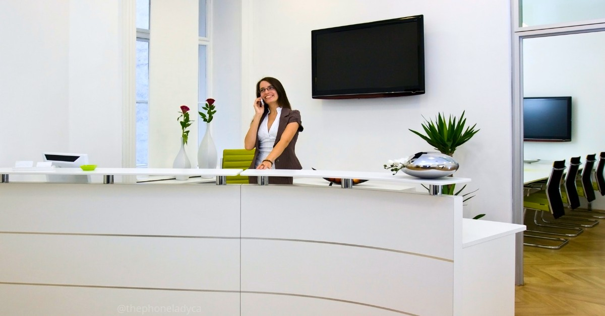 receptionist speaking on phone behind desk